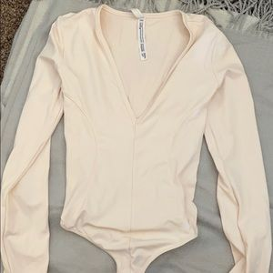 Never worn pale pink body suit